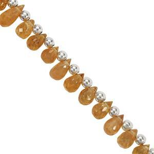 22cts Spessartite Faceted Drops Approx 4x3MM to 6x3.5MM 19cm Strand With Spacers