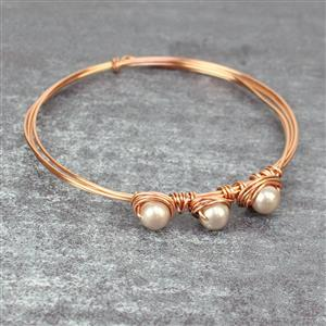 Loops of Roses: Swarovski beads, 4mm,6mm & 8mm Champagne shell pearls & rose gold wires