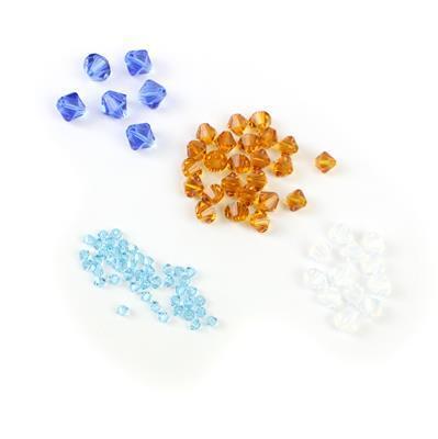 White Beaches! Inc; White Opal, Topaz, Aquamarine & Sapphire Swarovski Bead Bicones