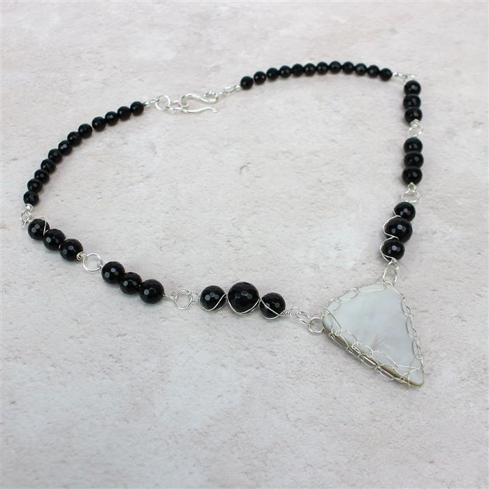 Shell We Dance; 245cts Multi Shape Shell, 160cts Black Agate & Sterling Silver Wire