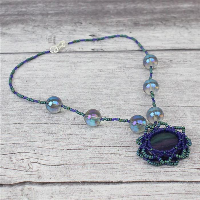 Fancy Stripes:Fluorite cabochons,blue coated quartz 12mm rounds, Swarovski beads,seedbeads