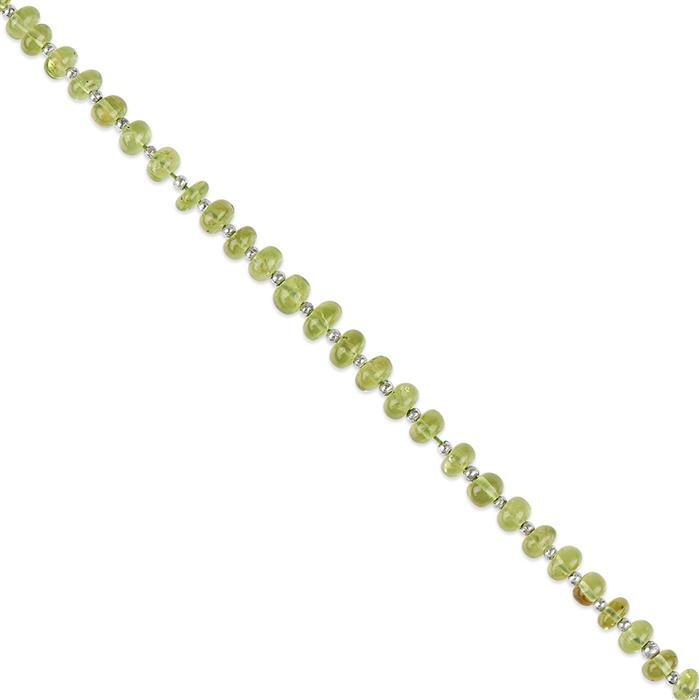 26cts Peridot Graduated Plain Rondelles Approx 2x1 to 5x3mm, 18cm Strand.